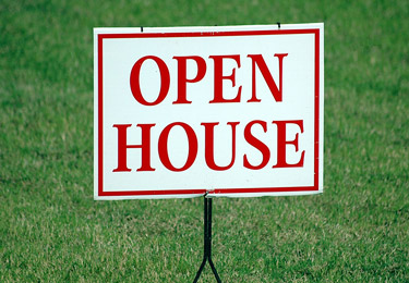 Forney, Texas — An open house sign against a green lawn.